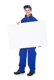 Male Worker Holding Blank Placard. Portrait Of Male Worker Holding Blank Placard On White Background Stock Images
