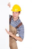 Male worker holding blank placard. Worker Wearing Hardhat And Holding Blank Placard Isolated On White Background Royalty Free Stock Photo