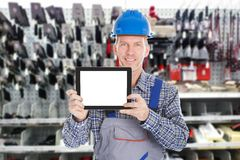 Male worker holding digital tablet. Portrait Of Mature Male Worker Holding Digital Tablet Stock Photos