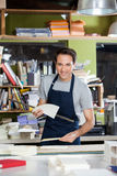 Male Worker Holding Papers And Ruler At Table Stock Photography