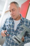 Male worker holding screwdriver. Male Royalty Free Stock Photo