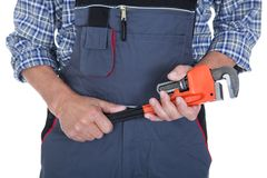 Male worker holding wrench. Portrait Of Male Worker Holding Wrench Over White Background Royalty Free Stock Photography