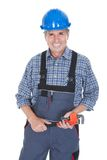 Male worker holding wrench. Portrait Of Male Worker Holding Wrench Over White Background Stock Photo
