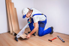Male Worker laminate flooring. At home Royalty Free Stock Photo