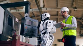 Male worker is launching a droid and walking away stock footage