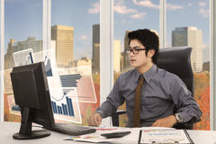 Male worker looking at virtual chart Royalty Free Stock Images
