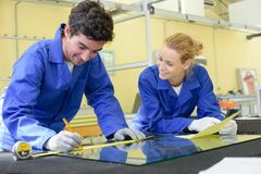 Male worker measuring glass. Man Stock Photos