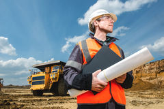 Male worker at an open pit. Engineer with documents. male worker at an open pit Stock Photo