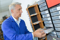 Male worker opening drawer cabinet. Male worker opening drawer of cabinet Royalty Free Stock Photos