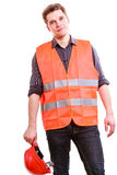 Male worker in orange uniform and helmet. Stock Image