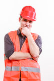 Male worker in orange uniform and helmet. Royalty Free Stock Image