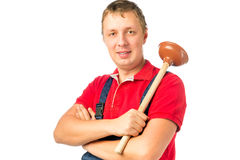 Male worker with a plunger Royalty Free Stock Photography