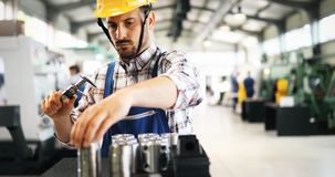 Male worker and quality control inspection in factory. Male worker and quality control inspection in metal industry factory Royalty Free Stock Photo