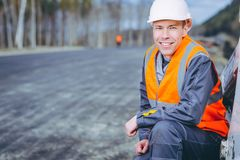 Male worker road construction. Infrastructure repair pavement Stock Photo