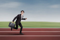 Male worker running on track racing Stock Photography