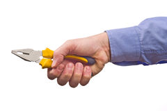 Male worker's hand holding combination pliers Royalty Free Stock Photo
