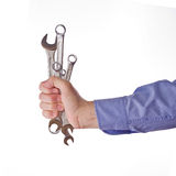 Male worker's hand holding set of wrenches. Part of series set of images with DIY tools for home jobs and crafts in hand isolated on white background Stock Image