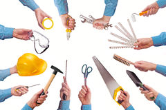 Male worker's hand holding various craft trade tools. Male worker's hand holding various crafts trade tools. Part of series set of images with DIY tools for home Royalty Free Stock Image