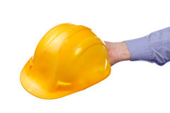 Male worker's hand holding yellow industrial protective helmet. Part of series set of images with DIY tools for home jobs and crafts in hand isolated on white Stock Photo