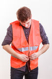 Male worker in safety vest. Job and work concept. Young handsome worker wearing orange uniform safety vest. Repairman inspector at work Royalty Free Stock Photo