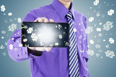 Male worker showing cellphone with currency symbols Stock Images