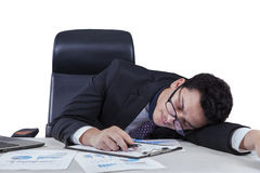 Male worker sleeping with documents on table Royalty Free Stock Images
