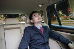 Male worker sleeping inside a car Royalty Free Stock Photo
