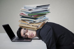 Male worker sleeping on laptop with paperwork Royalty Free Stock Image