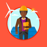 Male worker of solar power plant and wind farm. Royalty Free Stock Images