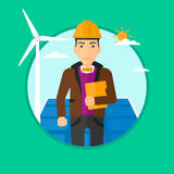 Male worker of solar power plant and wind farm. Stock Images