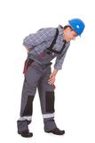 Male worker suffering from ache. Male Worker Suffering With Pain Over White Background Stock Images