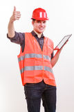 Male worker with tablet. Technological development in company. Young handsome man worker in safety vest and hard hat with tablet. Repairman inspector at work Royalty Free Stock Image