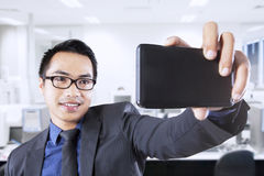 Male worker taking self photo Royalty Free Stock Photography