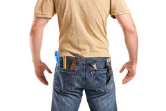 Male worker with tools in back pocket on jeans. Isolated on white background Royalty Free Stock Photos