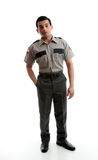Male worker in uniform. A male worker wearing uniform is standing with one hand in pocket on a white background Royalty Free Stock Image