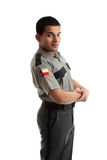 Male worker in uniform standing sideways. A male worker in uniform Stock Photography