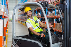 Male worker using forklift. In warehouse Stock Photography