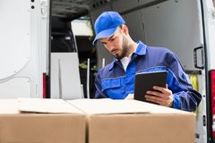 Male Worker Using Tablet. Portrait Of A Happy Young Male Worker Using Tablet Royalty Free Stock Image