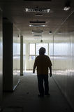 Male worker walking through corridor Stock Photos