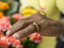 Male Worker Wearing Little Finger Ring. In The Garden Stock Photography