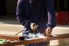 Male Worker Welding Steel or Metal. Male Worker or Welder Welding Steel or Metal at Construction Site Workshop Project Royalty Free Stock Images