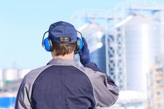 Free Male Worker With Headphones Outdoors Stock Image - 112533891