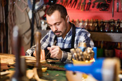 Male worker working on leather for belt in leather Royalty Free Stock Photo