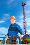 Male worker in a working uniform with pipe valve Stock Photography