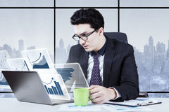 Male worker working with virtual chart Royalty Free Stock Photography