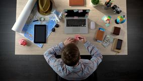 Male worker writing note on colourful sticker, creative idea for startup project. Stock photo Royalty Free Stock Photo