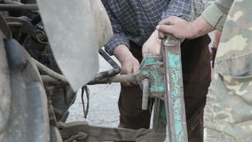 Male workers attach machinery Agricultural stock footage