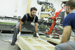 Male workers  in a factory Royalty Free Stock Image