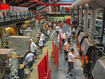 Male workers working on making glass at Riedel in Kufstein, Aust Royalty Free Stock Photos