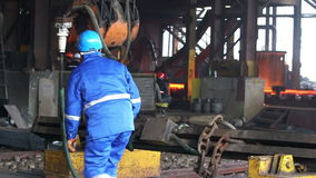 Male workers works in the Foundry. Male workers in action of hard works in the Foundry factory stock footage